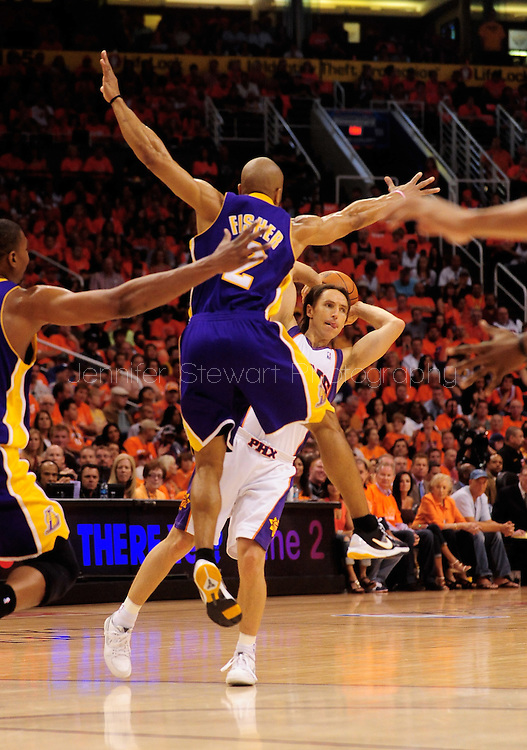 May 29, 2010; Phoenix, AZ, USA; Phoenix Suns guard Steve Nash (13) makes a pass against Los Angeles Lakers guard Derek Fisher (2) during the first quarter in game six of the western conference finals in the 2010 NBA Playoffs at US Airways Center.  Mandatory Credit: Jennifer Stewart-US PRESSWIRE