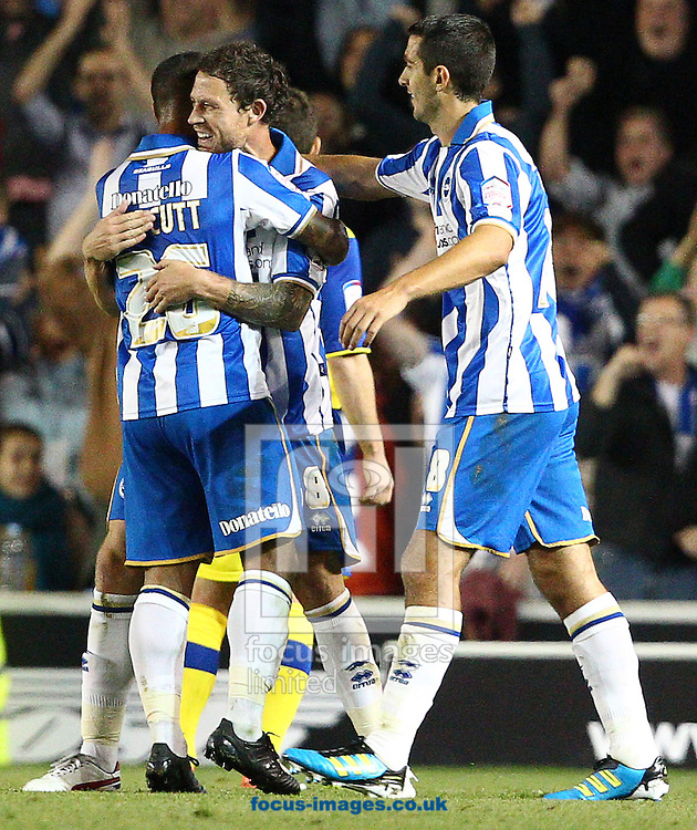 Picture by Paul Terry/Focus Images Ltd +44 7545 642257.14/09/2012.Wayne Bridge ( C ) of Brighton and Hove Albion celebrates after scoring the first goal from a free kick during the npower Championship match at the American Express Community Stadium, Brighton and Hove.