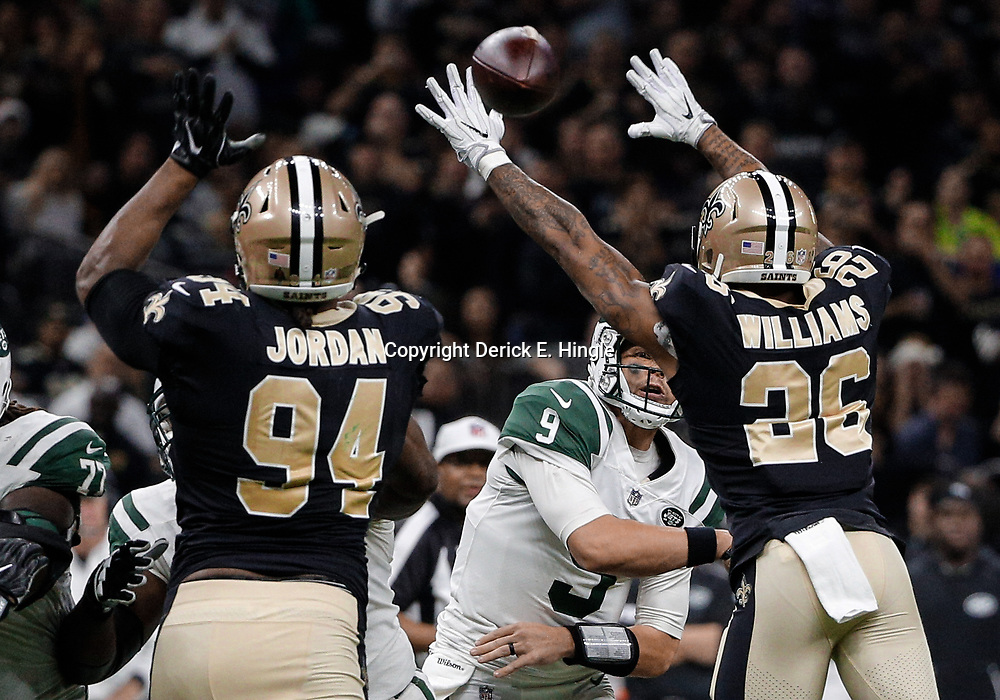 Dec 17, 2017; New Orleans, LA, USA; New York Jets quarterback Bryce Petty (9) throws as New Orleans Saints cornerback P.J. Williams (26) and defensive end Cameron Jordan (94) pressure during the second quarter at the Mercedes-Benz Superdome. Mandatory Credit: Derick E. Hingle-USA TODAY Sports