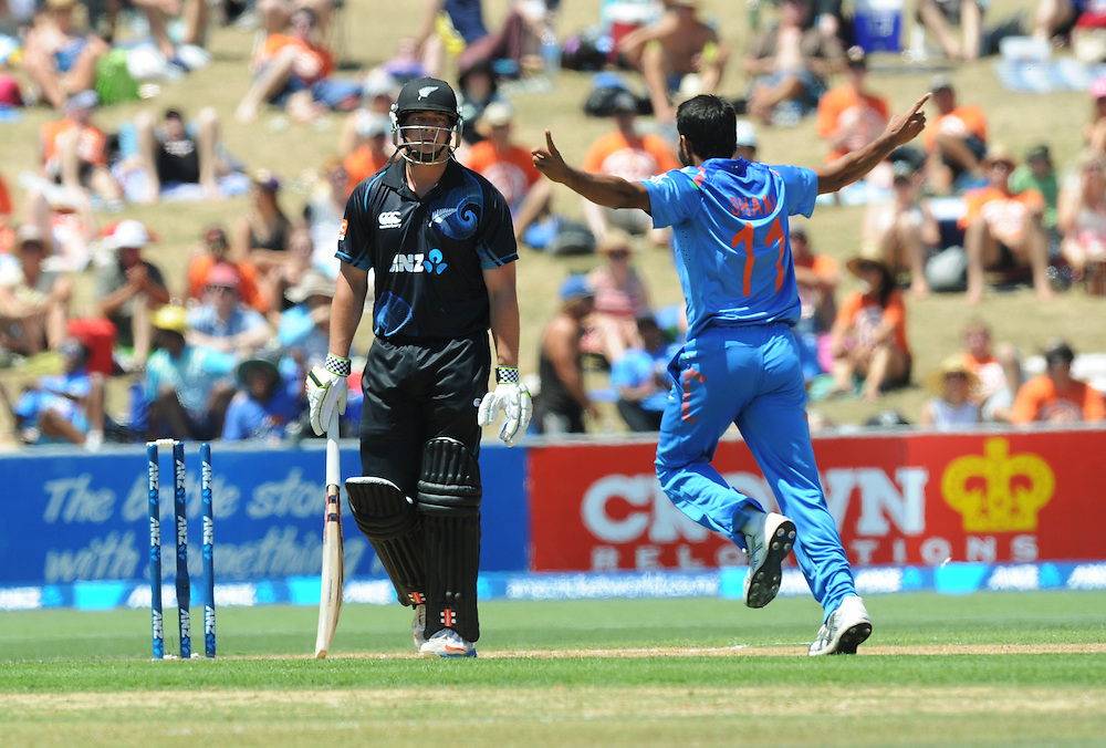 India's Mohammed Shami, right, celebates after bowling New Zealand's Jessie Ryder for 18 in the first one day International cricket match, McLean Park, New Zealand, Sunday, January 19, 2014. Credit:SNPA / Ross Setford
