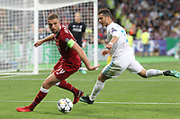 KIEV, UKRAINE - MAY 26: Jordan Henderson of Liverpool competes with Cristiano Ronaldo of Real Madrid during the UEFA Champions League final between Real Madrid and Liverpool at NSC Olimpiyskiy Stadium on May 26, 2018 in Kiev, Ukraine. (MB Media)