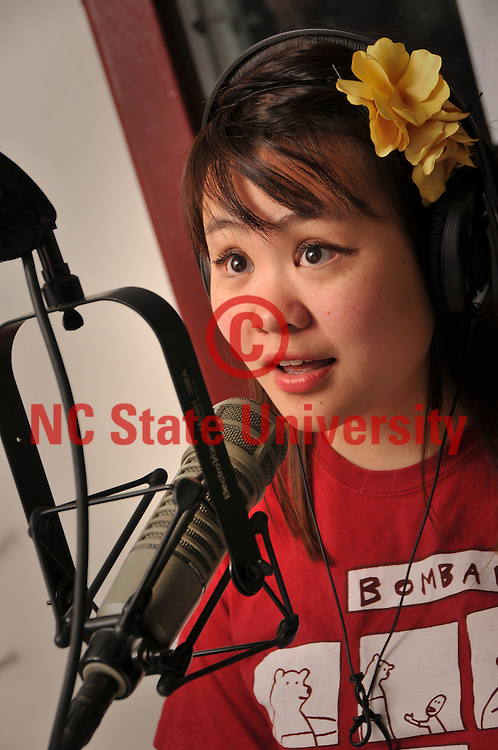 WKNC disc jockey May Chung intros the next song during her shift at the radio station.