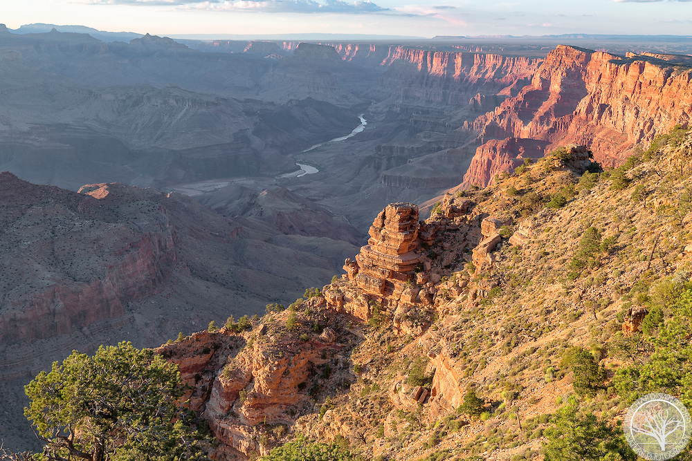 Sunset lights the cliffs overlooking the Colorado River, as seen from the Desert View Point. South Rim of the Grand Canyon National Park, Arizona