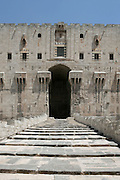 The Entrance Tower to the outer gateway of the Citadel, Aleppo, Syria. Standing on a mound covered in limestone blocks the Citadel is at the heart of Aleppo. Beneath it archaeological remains dating back as far as the 9th century BC have been discovered. Sayf al-Dawla (944-967), the first Hamdanid ruler of Aleppo, built the fortress and used the citadel as a military center. Zangid ruler Nur al-Din (1147-1174) fortified the citadel and added some structures. But during the Ayyubid period and the reign of the Sultan al-Zahir al-Ghazi of Aleppo (1186-1216), the Citadel went through major reconstruction, fortification and addition of new structures that create the complex of the Citadel in its current form.