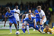 Gillingham defender Max Ehmer (5) scrambles the ball away during the EFL Sky Bet League 1 match between Gillingham and Oldham Athletic at the MEMS Priestfield Stadium, Gillingham, England on 8 October 2016. Photo by Martin Cole.