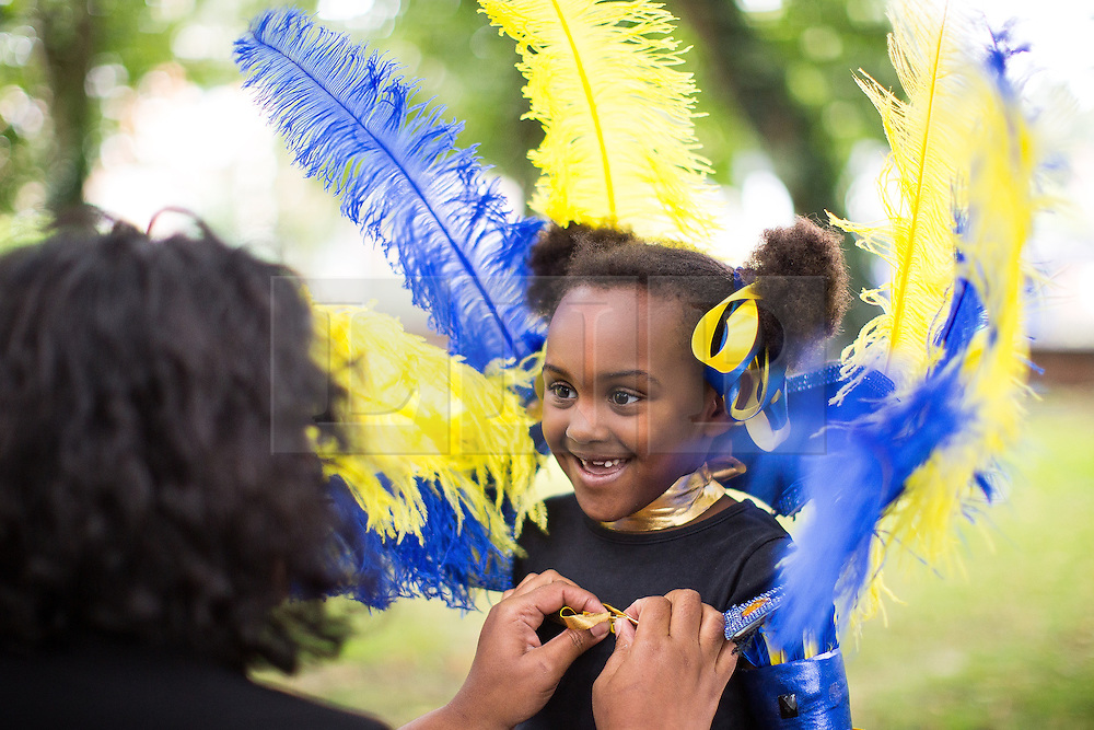 © Licensed to London News Pictures . 13/08/2016 . Manchester , UK . People getting their costumes ready for the annual Caribbean Carnival Parade through Hulme and Moss Side in South Manchester . Photo credit : Joel Goodman/LNP