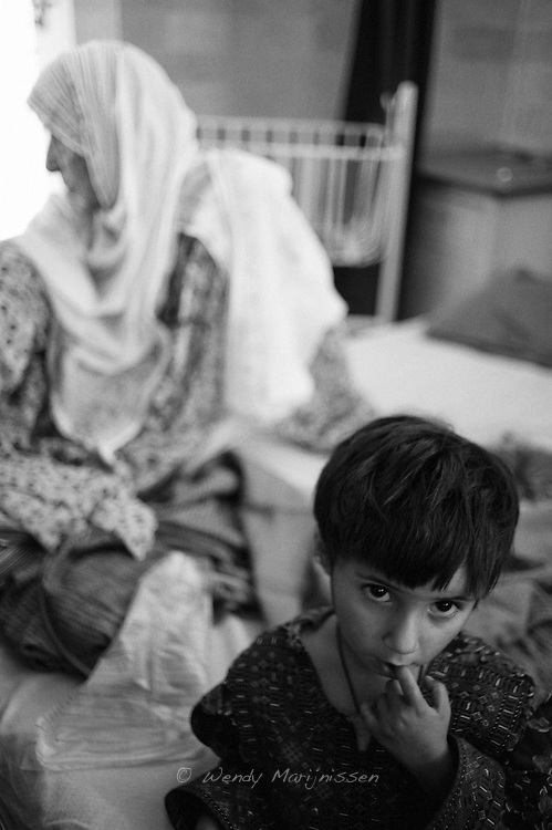A 50 year old fistula patient from Jamkanda, a village 10 miles from Karachi and her grandchild in the fistula ward of the Koohi Goth Womens hospital. After having had her fistula repair surgery she is now in hospital for a check up..Karachi, Pakistan, 2009.