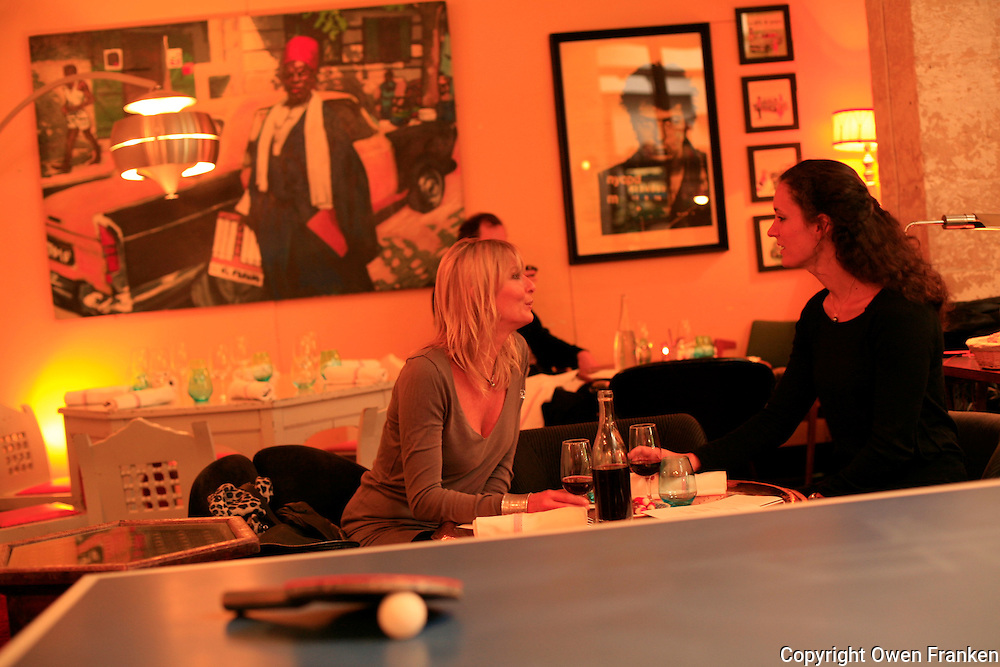 The restaurant Derriere, in the Marais in Paris, a favorite of the fashion crowd..The main dining area and the ping pong table.October 6, 2009..Photograph by Owen Franken for the NY Times - Photograph by Owen Franken