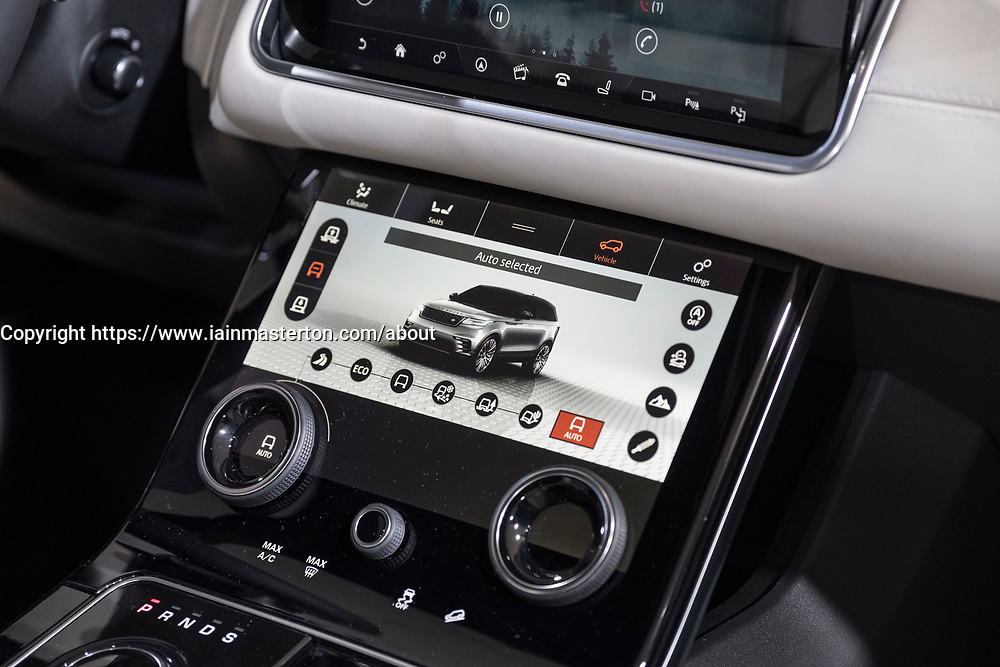 Detail of touchscreen control panel inside new Land Rover Velar luxury SUV on launch day at Geneva International Motor Show 2017