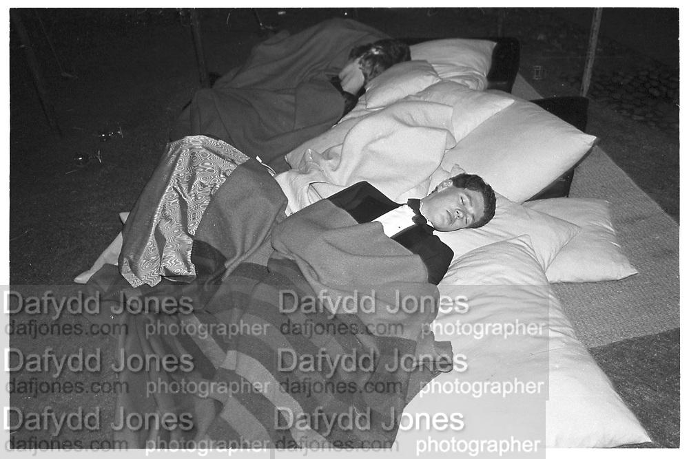 Sleeping during the Trinity Hall May Ball. Cambridge. 14 June 1983. film 83406f15