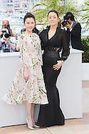 "CANNES, FRANCE - MAY 20:  Huiwen Zhang and Gong  Li attends the ""Coming Home"" photocall at the 67th Annual Cannes Film Festival on May 20, 2014 in Cannes, France.  (Photo by Tony Barson/FilmMagic)"