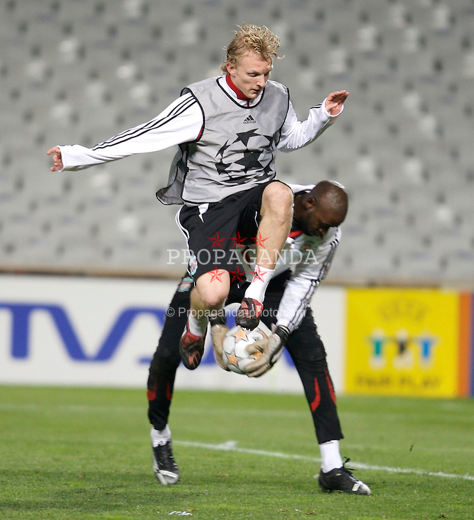 MARSEILLE, FRANCE - Monday, December 10, 2007: Liverpool's Dirk Kuyt and goalkeeper Charles Itandje training at the Stade Velodrome ahead of the final UEFA Champions League Group A match against Olympique de Marseille. Liverpool must win to progress to the knock-out stage. (Photo by David Rawcliffe/Propaganda)