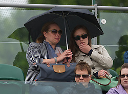 LONDON, ENGLAND - Monday, July 2, 2012: Fans shelter from the rain during the Ladies' Singles 4th Round match on day seven of the Wimbledon Lawn Tennis Championships at the All England Lawn Tennis and Croquet Club. (Pic by David Rawcliffe/Propaganda)