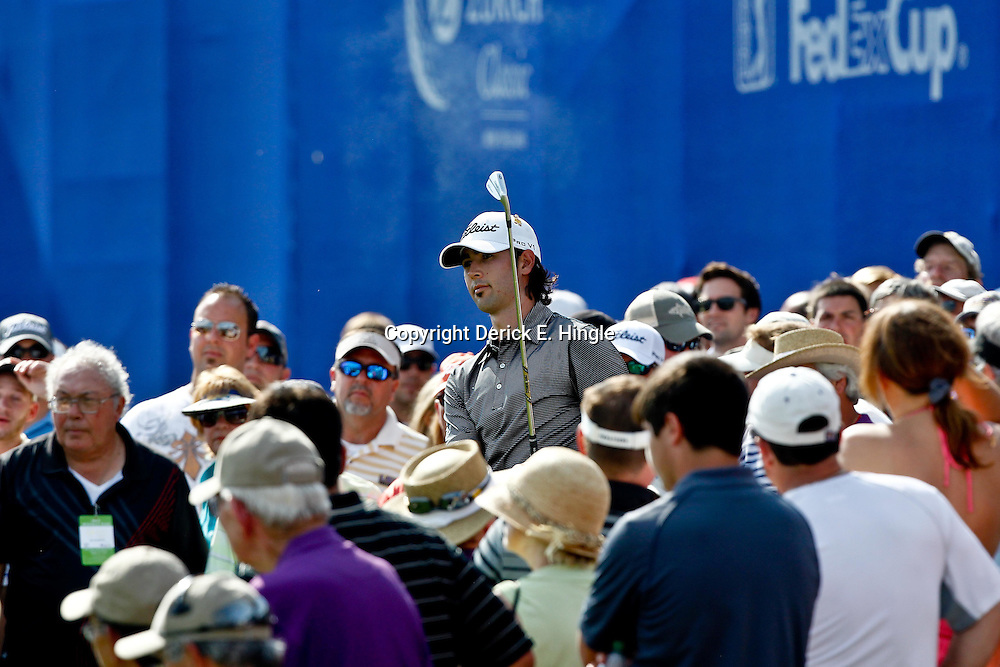 Apr 29, 2012; Avondale, LA, USA; Cameron Tringale hits from between fans on the 18th hole during the final round of the Zurich Classic of New Orleans at TPC Louisiana. Mandatory Credit: Derick E. Hingle-US PRESSWIRE