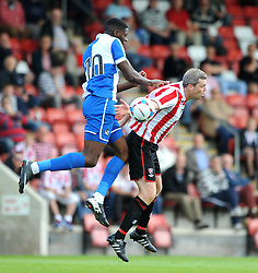 Nathan Blissett of Bristol Rovers challenges for the aerial ball with Arron Downes of Cheltenham Town - Mandatory by-line: Dougie Allward/JMP - 25/07/2015 - SPORT - FOOTBALL - Cheltenham Town,England - Whaddon Road - Cheltenham Town v Bristol Rovers - Pre-Season Friendly