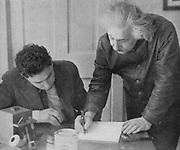 Albert EINSTEIN (1879-1955), German-Swiss-American mathematical physicist, with a student