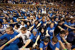 "DURHAM, NC - JANUARY 15: The ""Cameron Crazies"", fans of the Duke Blue Devils, antagonize and ""hex"" the Virginia Cavaliers on January 15, 2011 at Cameron Indoor Stadium in Durham, North Carolina. Duke won 70-86. (Photo by Peyton Williams/Getty Images)"
