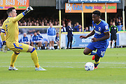 AFC Wimbledon striker Dominic Poleon (10) rounds Gillingham FC goalkeeper & captain Stuart Nelson (1) and scores a goal 1-0 during the EFL Sky Bet League 1 match between AFC Wimbledon and Gillingham at the Cherry Red Records Stadium, Kingston, England on 1 October 2016. Photo by Stuart Butcher.