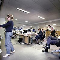Nederland, Amsterdam , 13 januari 2011..ZZP-ers zoals architect Bendien Wieringa (l) in hun gemeenschappelijke werkruimte die ze huren in het voormalige Parool gebouw aan de Wibautstraat tegenwoordig een broedplaats van ZZpers.Foto:Jean-Pierre Jans