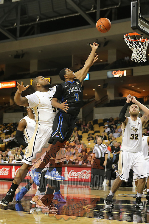 ORLANDO, FL - DECEMBER 31:  Shaquille Harrison #3 of the Tulsa Golden Hurricane drives to the net during an NCAA basketball game against the UCF Knights at the CFE Arena on December 31, 2014 in Orlando, Florida. (Photo by Alex Menendez/Getty Images) *** Local Caption *** Shaquille Harrison