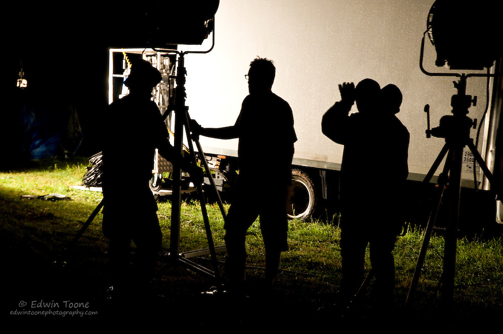 Shadows of the crew as they set up the lights.