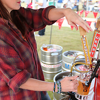 Libby Ezell | BUY at PHOTOS.DJOURNAL.COM<br /> Carol Samarov pours one of many Better Beer brands at Thursday's Octoberfest