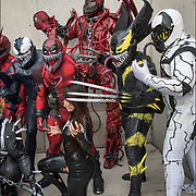 Cosplayer in their  Vernom costumes as Vernom Carnage group photo outdoors  at the New York ComicCon. Carnage is a fictional character, a supervillain appearing in American comic books published by Marvel Comics. The character first appeared in The Amazing Spider-Man #360. Carnag is the character belongs to a race of amorphous extraterrestrial parasites known as the Symbiotes. He is usually depicted as an adversary to Spider-Man, as well as serving as the archenemy of Venom. The symbiote has taken many hosts. <br /> <br /> More than 200,000 people attended the event dressed up as their favorite superhero to celebrate comic books, sci-fi and video games.<br /> <br /> The New York Comic Con convention, is a  celebration of comic books, graphic novels, sci-fi and video games, toys, movies and television.