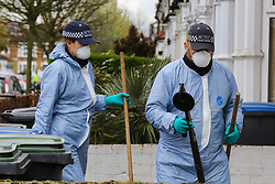 © Licensed to London News Pictures. 02/04/2019. London, UK. The search team officers carrying out the search house by house on Fairfield Road, Edmonton, North London looking for the clues. A man in his 30s was stabbed just after 5am this morning. He is in a life threatening condition. On Sunday 31 March 2019, four people were stabbed in just 14 hours during knife attacks within a quarter-mile radius in Edmonton North London, including one on Aberdeen Road. Two men were arrested on suspicious of grievous bodily harm. Photo credit: Dinendra Haria/LNP
