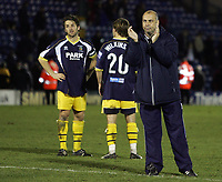 Photo: Paul Thomas.<br /> Bury v Weymouth. The FA Cup. 21/11/2006.<br /> <br /> Dejected manager Garry Hill (R) and his Weymouth team thank their travelling fans.