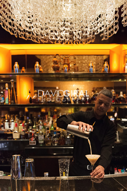 Barman preparing cocktails at the Club Privé inside the Bellagio Hotel in Las Vegas, Nevada