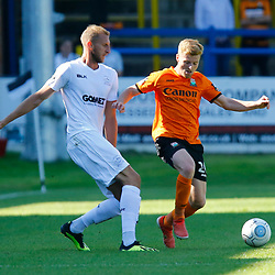 Barnets forward Jack Barham and Dovers defender Tim Schmoll during the National League match between Dover Athletic and Barnet FC at Crabble Stadium, Kent on 1 September 2018. Photo by Matt Bristow.