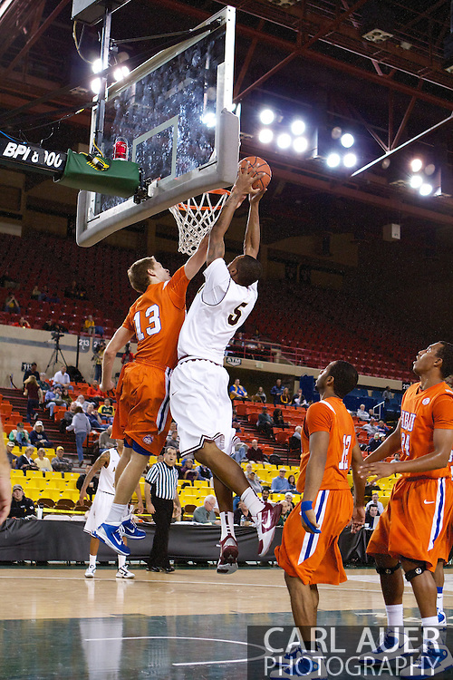 November 25th, 2010:  Anchorage, Alaska - Arizona State forward Kyle Cain (5) attempts a dunk over the Houston Baptist defense in the Sun Devil victory over the Huskies, 73-55, at the Great Alaska Shootout.