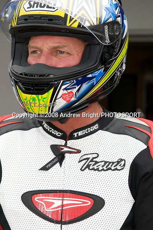 1988 and '89 World Superbike Champion Fred Merkel (now a Taupo resident) waits for team mate Jamie Rajek to pit during the B.A.D.D. 3 hour endurance motorcycle race at Taupo Motorsport Park. Monday 29th December 2008. (NOTE: Fred's leathers are incorrectly labelled with the name Travis) Photo: Andrew Bright/PHOTOSPORT