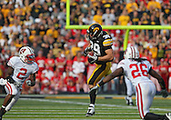 October 23 2010: Iowa Hawkeyes tight end Brad Herman (39) tries to pull in a pass in front of Wisconsin Badgers cornerback Jay Valai (2) and Wisconsin Badgers cornerback Antonio Fenelus (26) during the first half of the NCAA football game between the Wisconsin Badgers and the Iowa Hawkeyes at Kinnick Stadium in Iowa City, Iowa on Saturday October 23, 2010. Wisconsin defeated Iowa 31-30.