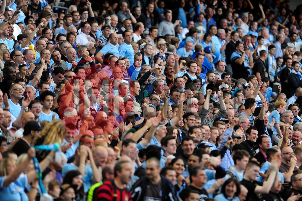 Manchester City fans - Photo mandatory by-line: Dougie Allward/JMP - Tel: Mobile: 07966 386802 22/09/2013 - SPORT - FOOTBALL - City of Manchester Stadium - Manchester - Manchester City V Manchester United - Barclays Premier League