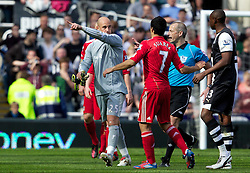 NEWCASTLE-UPON-TYNE, ENGLAND - Sunday, April 1, 2012: Liverpool's goalkeeper Jose Reina points dejected to Newcastle United's James Perch to meet outside the pitch after being sent off by referee Martin Atkinson during the Premiership match at St James' Park. (Pic by Vegard Grott/Propaganda)