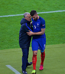 PARIS, FRANCE - Sunday, July 3, 2016: France's two-goal hero Olivier Giroud is congratulated by head coach Didier Deschamps as he is substituted against Iceland during the UEFA Euro 2016 Championship Semi-Final match at the Stade de France. (Pic by Paul Greenwood/Propaganda)