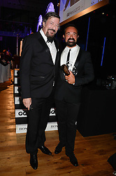 Left to right, STEPHEN FRY and EVGENY LEBEDEV winner of the Entrepreneur of the Year Award at the GQ Men of The Year Awards 2013 in association with Hugo Boss held at the Royal Opera House, London on 3rd September 2013.