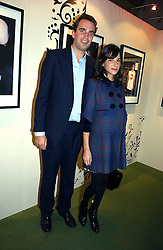 FRITZ VON WESTENHOLZ and CAROLINE SIEBER at a party to launch the One T-Shirt by Edun held at Harvey Nichols, Knightsbridge, London on 18th October 2006.<br />