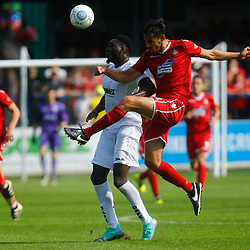 Wrexhams midfielder Luke Young hooks the ball around Dovers forward Inih Effiong during the opening National League match between Dover Athletic and Wrexham FC at Crabble Stadium, Kent on 04 August 2018. Photo by Matt Bristow.