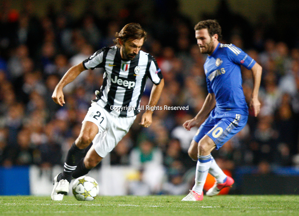 19.09.12 London, ENGLAND: <br /> Andrea Pirlo of Juventus F.C. takes on Juan Mata of Chelsea<br /> during the UEFA Champions League Group E match between Chelsea and  Juventus at Stamford Bridge Stadium