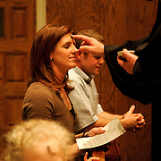First United Methodist Church Associate Pastor Steve Brooks applies an ash and oil mixture to Rita Simmons forehead Wednesday during the church's Ash Wednesday service.  Ash Wednesday traditionally marks the beginning of Lent, the 40 days before Easter, for Christians.