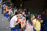 01 MARCH 2008 -- BANGKOK, THAILAND: People eat off street carts in near Silom Road in Bangkok, Thailand.    Photo by Jack Kurtz