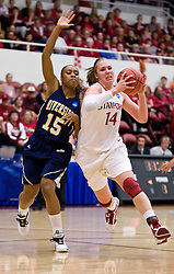 March 20, 2010; Stanford, CA, USA; Stanford Cardinal forward Kayla Pedersen (14) dribbles past UC Riverside Highlanders guard/forward Brittany Waddell (15) during the first half in the first round of the 2010 NCAA womens basketball tournament at Maples Pavilion.  Stanford defeated UC Riverside 79-47.
