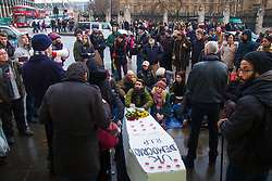 "London, February 14th 2015. A few dozen activists from Occupy Democracy gather at Parliament Sqyuuare to hold a vigil and funeral for British democracy, which they say has been killed by Parliaments apparent alliance with corporates at the expense of the ""99%"".  PICTURED:  Curious tourists and activists listen to speakers.  // Photographer contact for payment details if not already on record: Tel 07966016 296, email paul@pau;ldaveycreative.co.uk."
