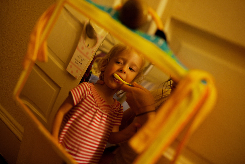 Melissa Eich, 23, brushes her daughter Madelyn's teeth before putting her in bed at their home in Norfolk, Virginia on Saturday, July 24, 2010.