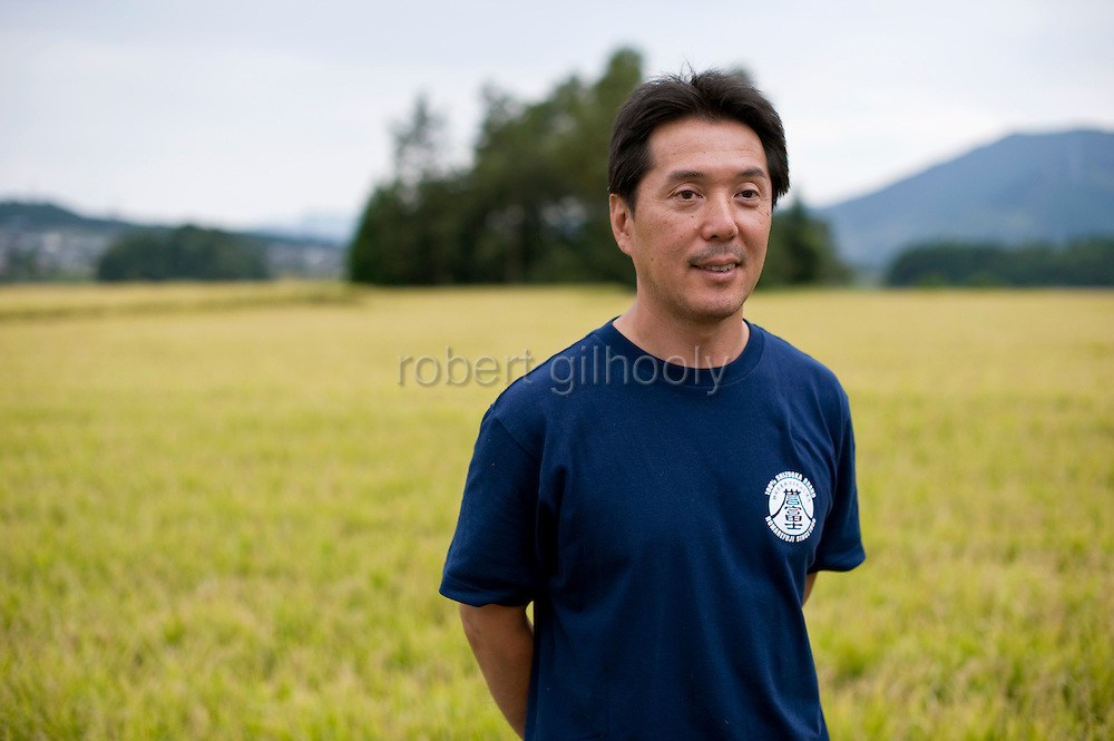 Shinichi Sei, president of Fuji-nishiki Sake Brewery stands by his rice fields in Fujinomiya, Shizuoka Prefecture Japan on 02 Oct. 2012.  Photographer: Robert Gilhooly