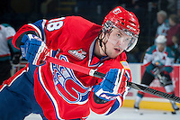 KELOWNA, CANADA -JANUARY 29: Reid Gow D #18 of the Spokane Chiefs takes a shot during warm up against the Kelowna Rockets on January 29, 2014 at Prospera Place in Kelowna, British Columbia, Canada.   (Photo by Marissa Baecker/Getty Images)  *** Local Caption *** Reid Gow;