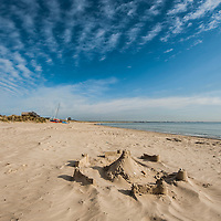 A view of a deserted beach with sand castle in England