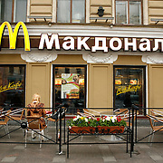 McDonald's restaurant on Nevsky Saint Prospect in Saint Petersburg, Санкт-Петербург, he second largest city in Russia, located on the Neva River near the Baltic Sea.<br /> Photography by Jose More